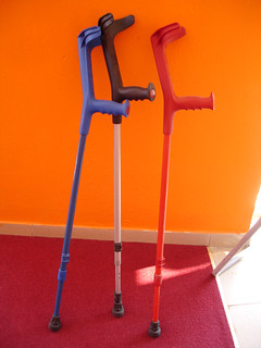 Crutches against orange wall | by allispossible.org.uk
