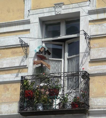 balcón con plantas y pajaritos