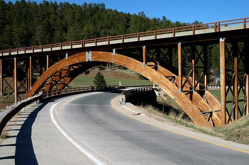 wood travel bridge mountains architecture southdakota blackhills forest photo highway arch photos timber bridges arches wikipedia keystone span rapidcity interchange bridging 200605 glulam skyarchitecture bridgepixing bridgepix keystonewye penningtoncounty bridgeblog