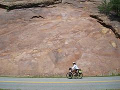 Raquel riding by rock
