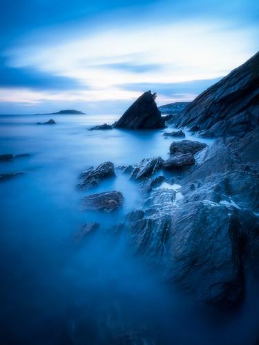 10stop looe sunset panasonic longexposure boulders rocks panasonic1235mmf28x beach millendreath nikcollection blue srbphotographic wideangle cornwall coast gx8 cloudsstormssunsetssunrises