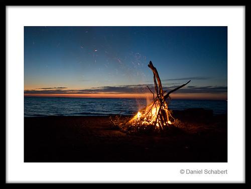 sunset water bonfire
