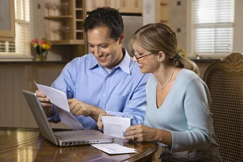 Couple Paying Bills Online | Couple paying bills online with… | Flickr