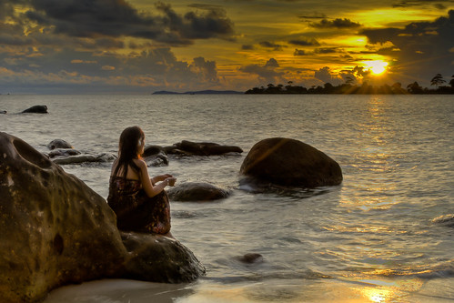 ocean travel sunset sea vacation sky people woman tourism nature water yellow loving clouds sunrise landscape asian outside seaside scenery rocks looking dress outdoor vibrant tide horizon watching shoreline young peaceful adventure shore short romantic relaxation majestic hdr oneperson pristine