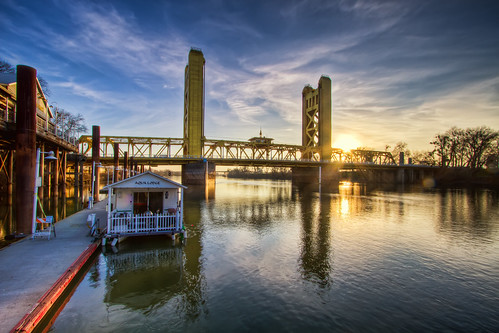 california old bridge blue light sunset sky reflection tower water river boat town colorful downtown state capital sacramento hdr