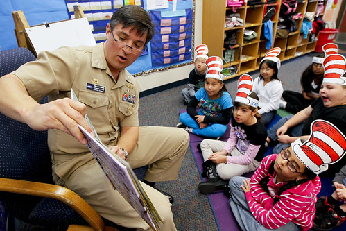 Navy Captain reads to students during Read Across America event. | by Official U.S. Navy Imagery