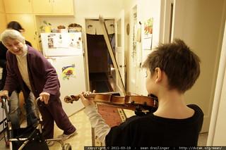 nick performing bluegrass fiddle in grandma joan's kitchen - MG 3649.JPG   by sean dreilinger
