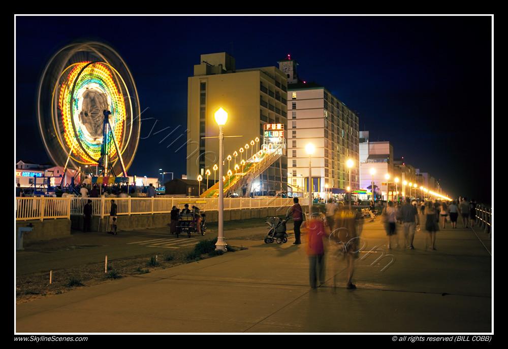 Virginia Beach boardwalk at night | People walking along the