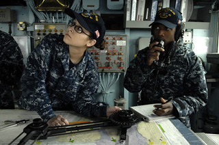 Sailors stand ready to recieve orders aboard USS Whidbey Island. | by Official U.S. Navy Imagery