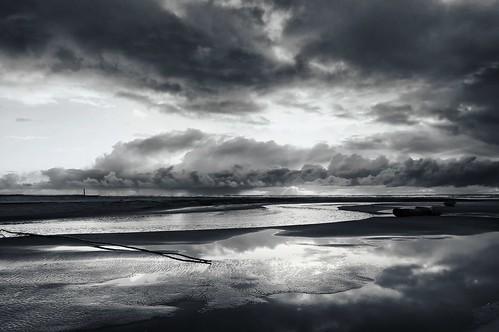 sunset blackandwhite seascape reflection beach clouds river landscape coast washington sand stream fineart washingtonstate tone oceanshores niksoftware silverefexpro andrewvernon nikond300s aperture3