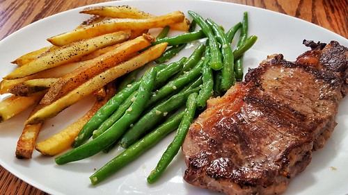 Mmm... rib eye with fries and garlic butter green beans | by jeffreyw