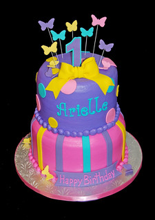 2 Tier Purple Turquoise Yellow And Pink Cake For A 1st Bir