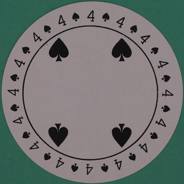 Discus Round Playing Card 4 of Spades