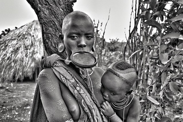 Surma woman with baby, Ethiopia