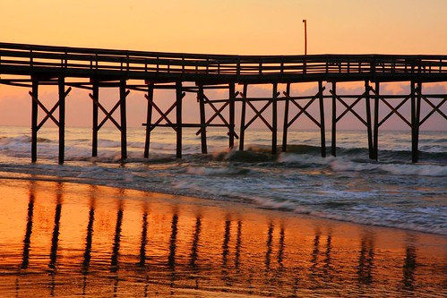 ocean morning red summer orange beach water june clouds sunrise reflections fire pier fishing waves north atlantic carolina isle 2011