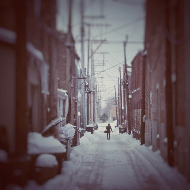 Small town alley walker in snow