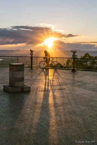 2017 australia brisbane mtcoottha mtcootthalookout qld queensland cyclist shadows sun sunburst sunrays sunrise bicycle bike