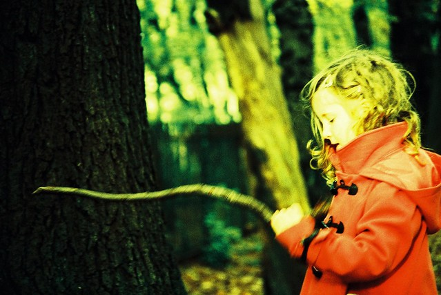 X-Pro: Girl with stick in woods