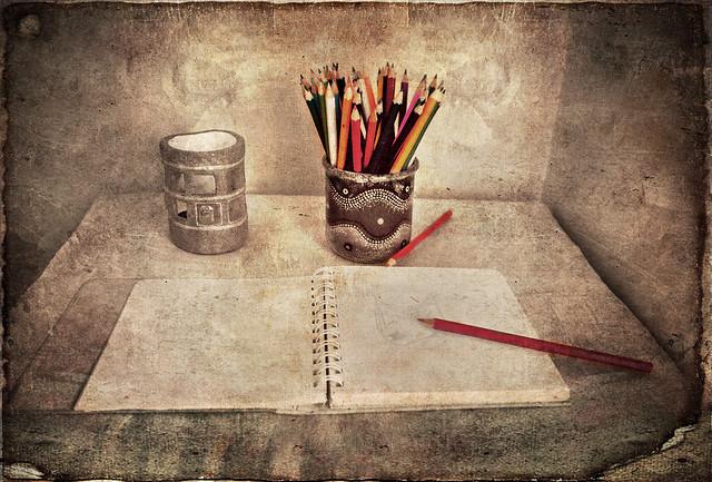 Sketchbook and coloured pencils