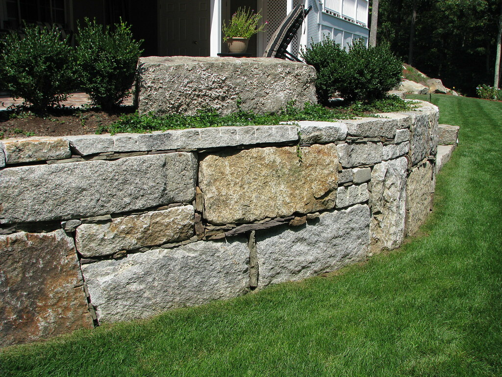 Reclaimed Granite Block Retaining Wall | The use of reclaime