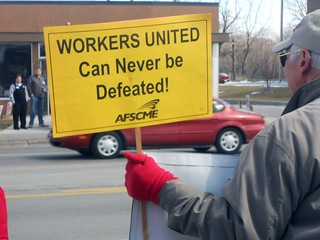 """WORKERS UNITED Can never be defeated"" 