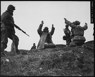 Men of the 1st Marine Division capture Chinese Communists during fighting on the central Korean front. Hoengsong, March 2, 1951., 1927 - 1981