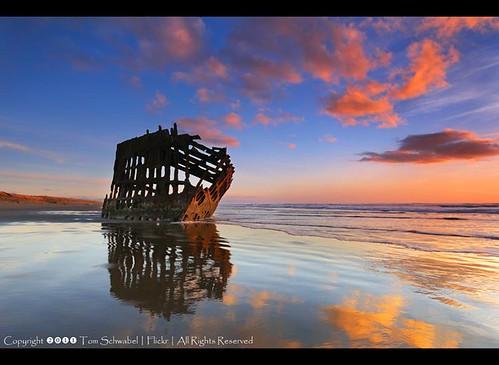 ocean sunset reflection beach clouds oregon coast sand rust pacific shipwreck wreck fortstevens peteriredale tomschwabel iredale
