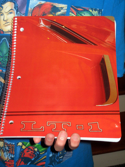 Front cover of a spiral-bound notebook with 4 photos of a 1970 Corvette