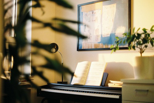 Piano in the evening light, Chopin notes waiting to be practiced | by jorge zapico