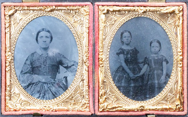 ambro_013 :: double portrait of woman and sisters clasping hands