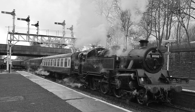 Class 4MT Tank Loco No. 80080 arrives at Bury Bolton Street, with a service from Heywood. East Lancs Railway. 27 03 2016 b&w