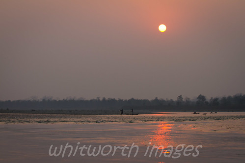 pink nepal sunset sky people orange sun color colour reflection nature water silhouette river landscape outdoors evening boat nationalpark fisherman haze asia dusk canoe pollution chitwan narayaniriver bandarjhola