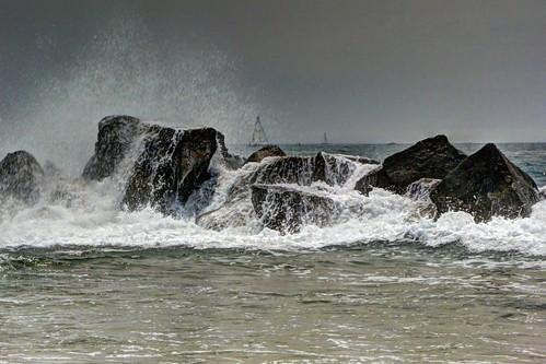 waveoverrocks breakingwaves crashing waves breakwater venicebeach california pacificocean sailboat beach joelach