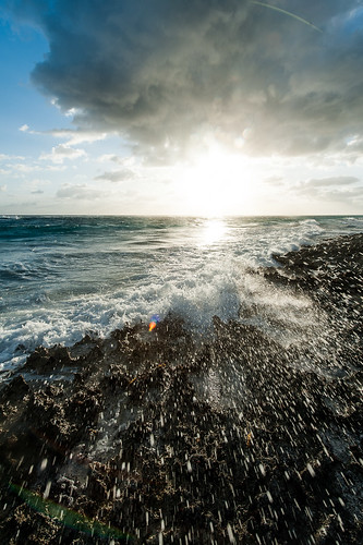 ocean morning sun water clouds sunrise rocks waves splash