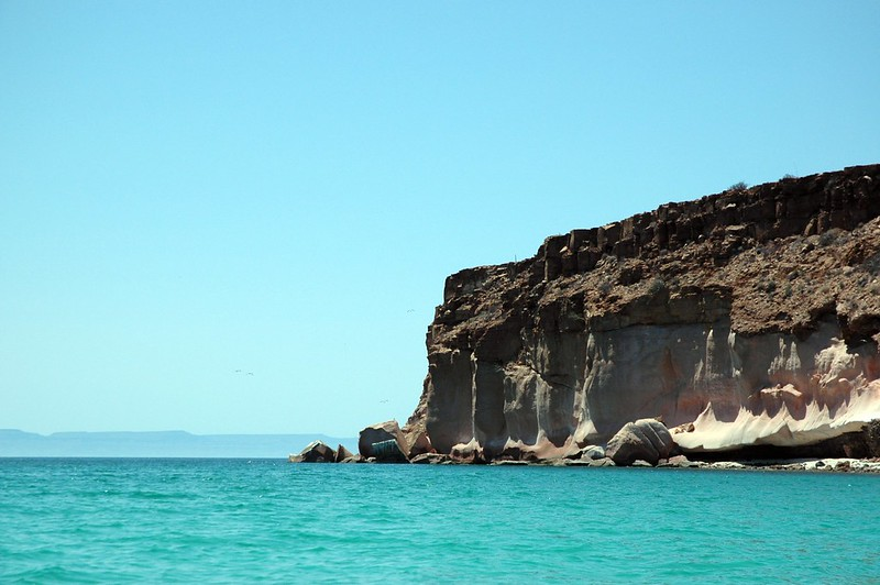 Incredible blue waters and sky, birds and sculpted cliffs south of La Paz, Baja California Sur, Mexico