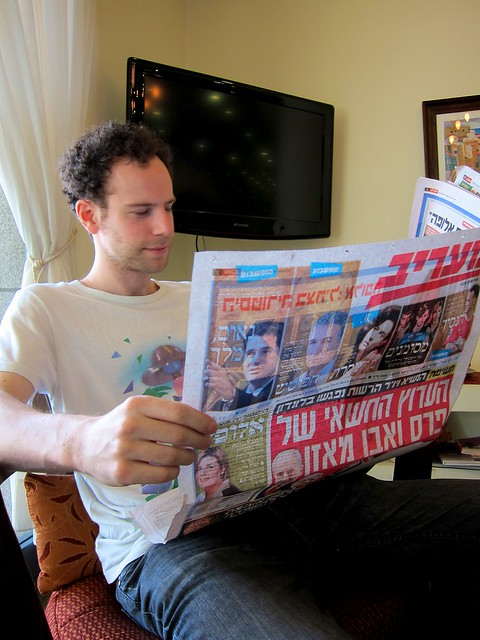 Adam Cohen Reads A Newspaper In Hebrew, Which He Entirely Understands