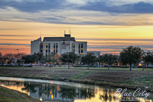 sunset sky orange reflection building water clouds canal health medicine emergency doctors hdr lakejackson photomatix brazoriacounty brazosportregionalhealthsystem bluecityphotography bluecityphotographycom brazosortmemorialhospital