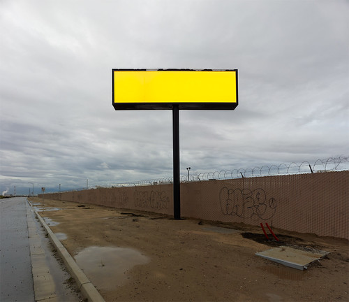 road ca usa sign horizontal clouds fence landscape graffiti solitude glow unitedstates empty overcast nopeople roadside largeformat bakersfield razorwire nocars colorimage almostsquare