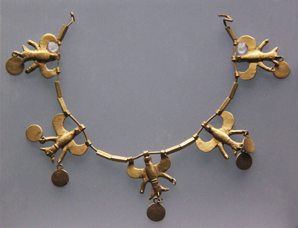 Gold necklace with flying eagles and pendant discs, from T