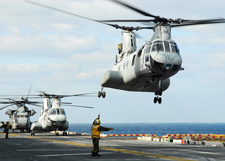 Helicopters lift off from USS Essex to support relief operations in Japan. | by Official U.S. Navy Imagery