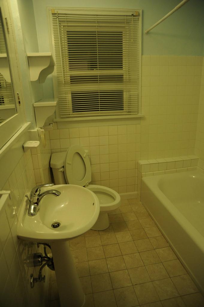 Rental House Bathroom Blue Walls Cream Colored Tile Whi