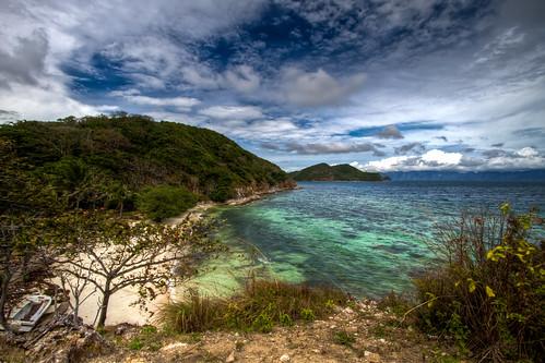 blue white mountain green beach water beautiful rock point island sand view cloudy scenic clean coron emerald palawan malcapuya