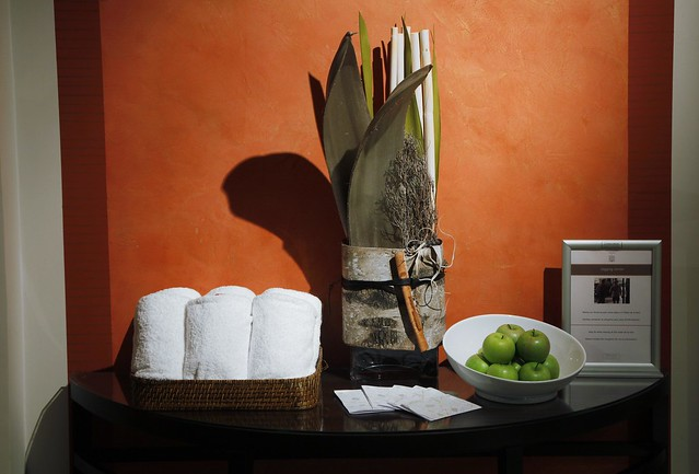 Notice regarding towel use in hotels along with an offer of fruit are nominal sustainability policies introduced by hotels.