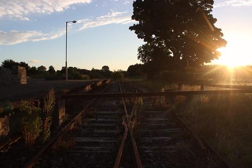 charlestown railway deserted abandoned sunset rays lamppost trees barrier comayo railwaytrack weeds light eveninglight ireland decay emigration railwaystation sleepers junction platform sad derelict
