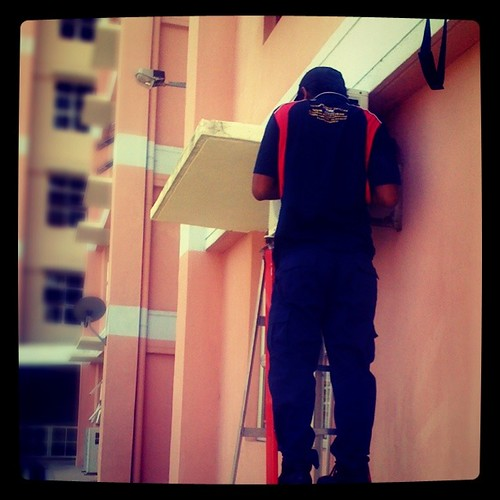 Air-cond guy doing his job.
