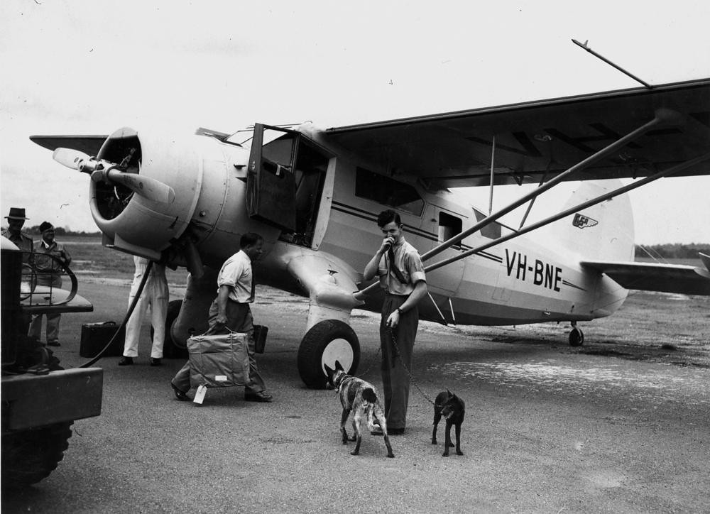 Noorduyn Norseman aircraft refuelling on the airstrip, possibly at Eagle Farm, 1948