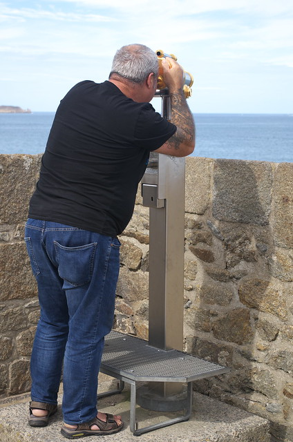 Man with telescope in St Malo