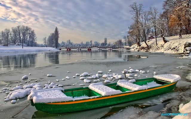 The boat trapped in a frozen river