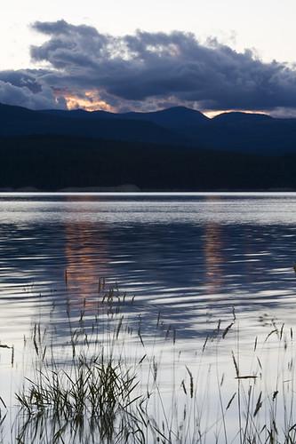 sunset wild summer plants usa lake mountains reflection water beautiful clouds landscape evening montana dusk august reservoir american northern koocanusa rexford