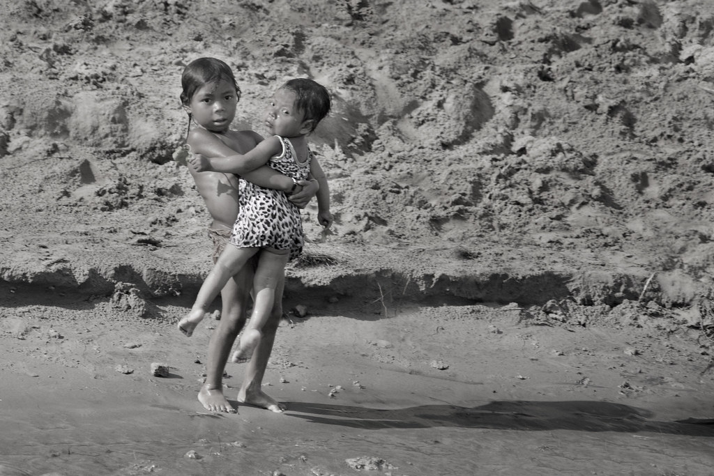 boy carrying sister